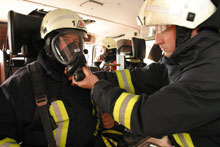 Firefighters wearing personal protective equipment (PPE)