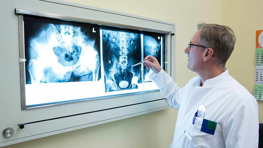 Doctor looking at X-ray image