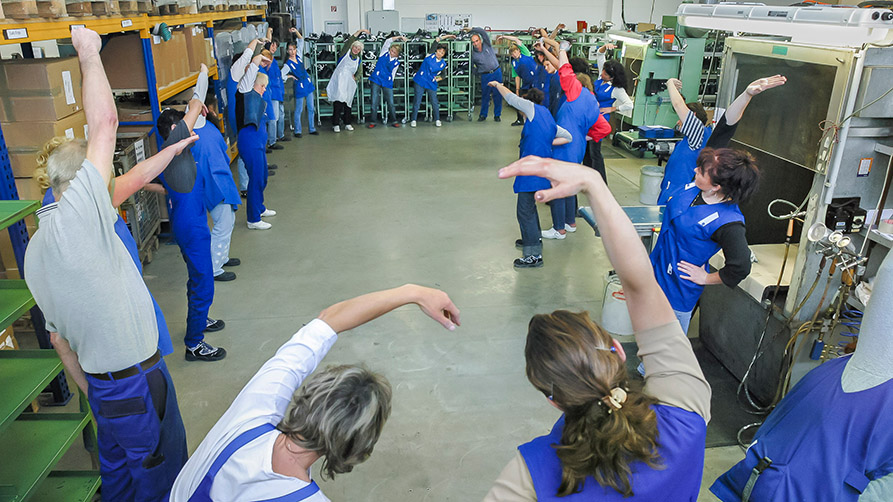 Stretch Break taking place in a factory hall